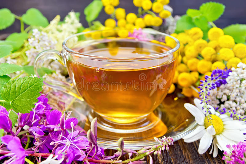 Tea from flowers in glass cup on board royalty free stock photo