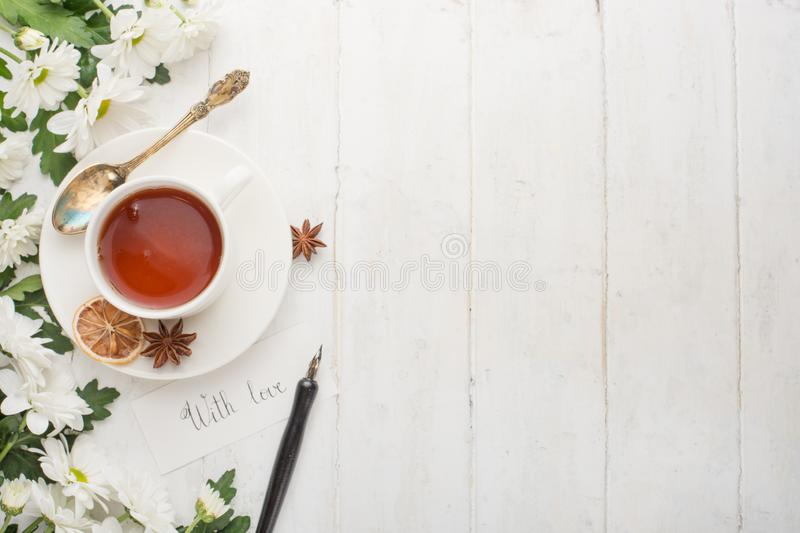 Tea with flowers is made with love. Top view with empty space for inscriptions.  royalty free stock image