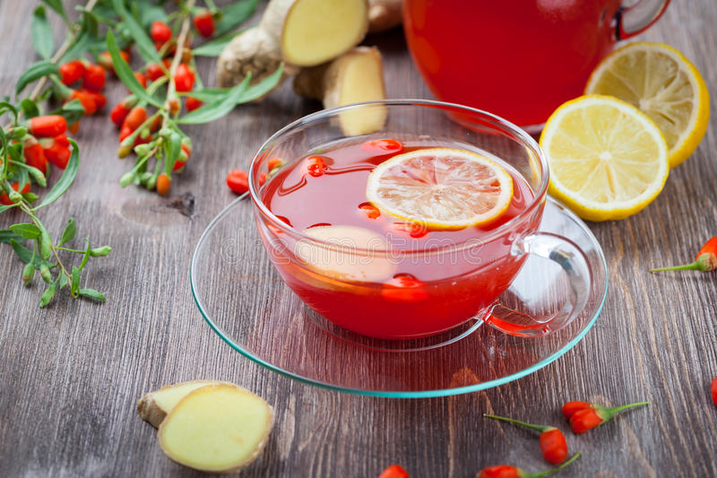 Tea with fresh goji berries royalty free stock photos