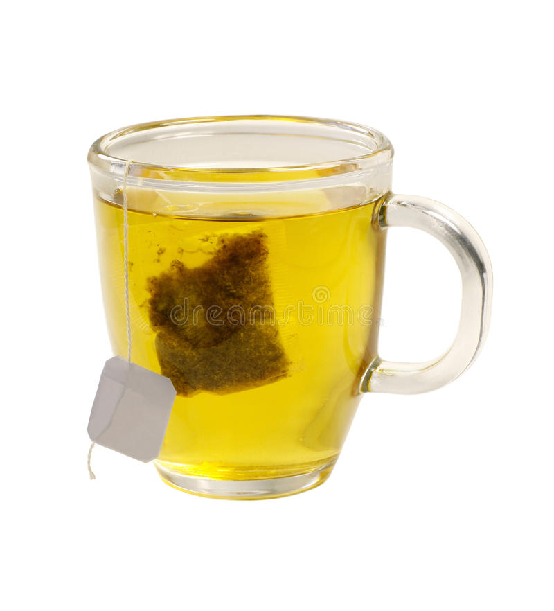 Tea glass of green tea with teabag on white backgr stock photo