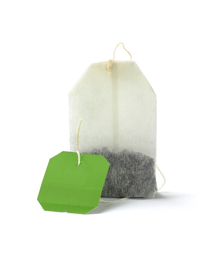 Tea hänger lös med den tomma etiketten royaltyfri fotografi