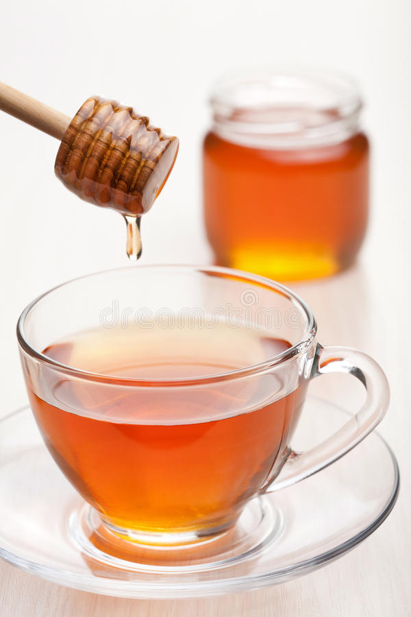 Tea with honey royalty free stock images