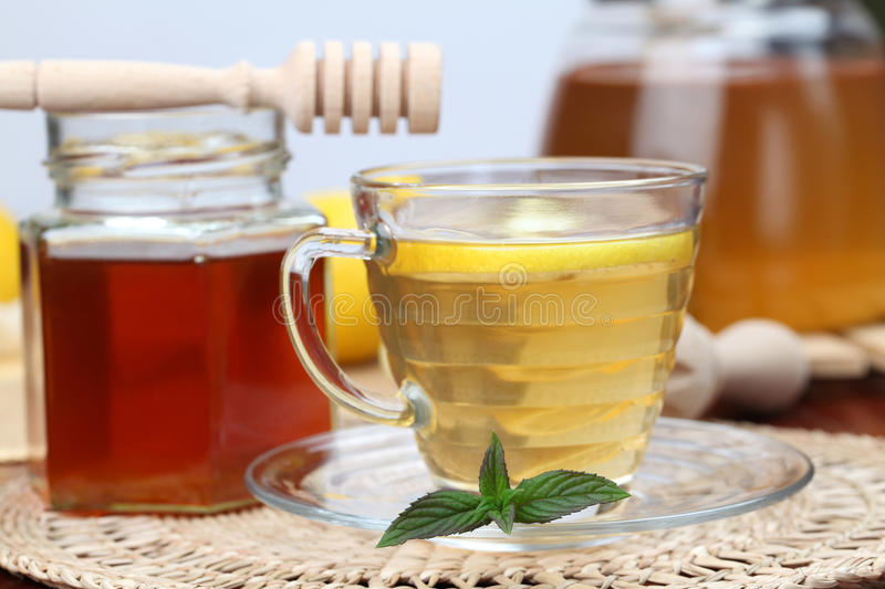 Tea with honey and lemon royalty free stock images