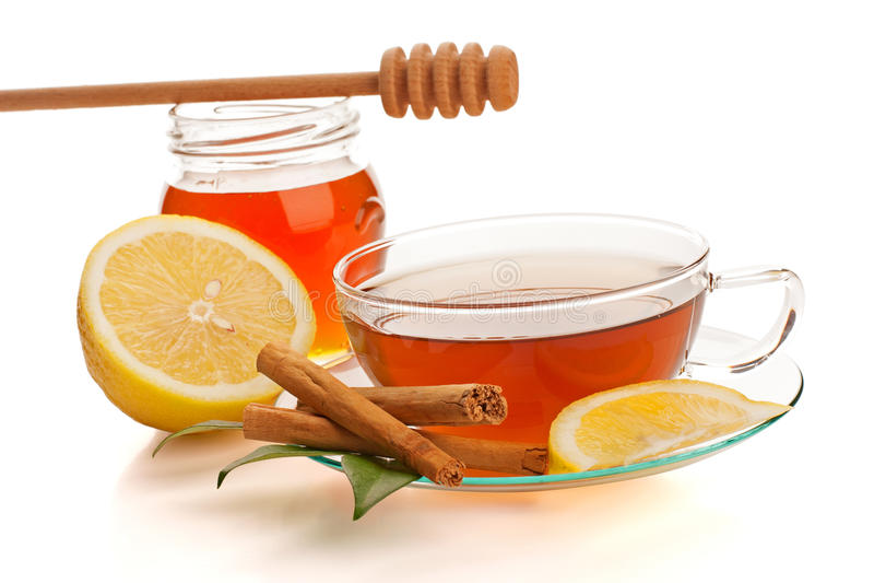 Tea with honey, lemon and cinnamon stock images
