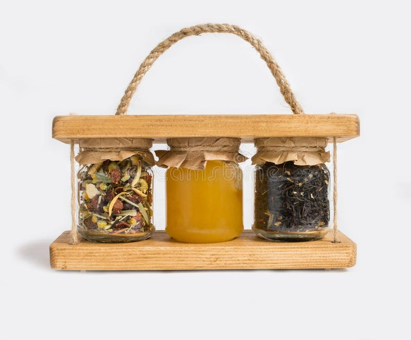 Tea and honey set in glass jars isolated on white background royalty free stock photo