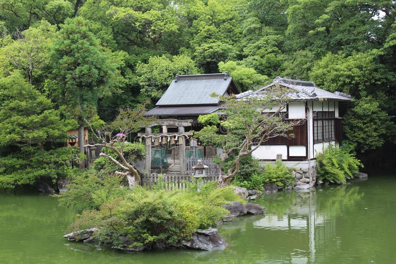 Tea house in a lake at Kyoto imperial palace. Tea house in the park area of Kyoto imperial palace, Japan royalty free stock images