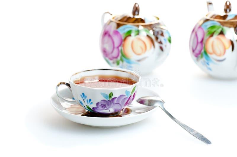 Tea i kopp arkivfoto