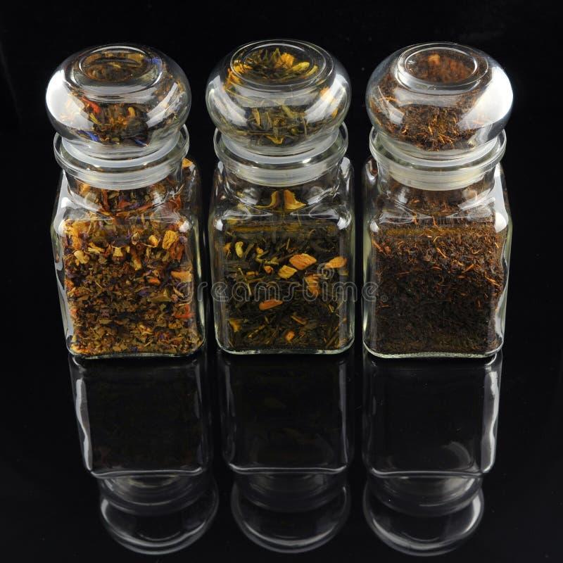 Tea Jars. On black background stock images