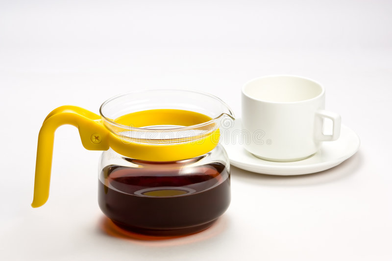 Tea kettle and cup royalty free stock photography