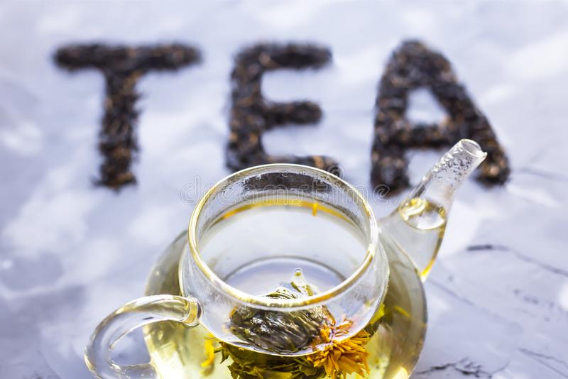`Tea` is laid out from dry tea leaves stock photo