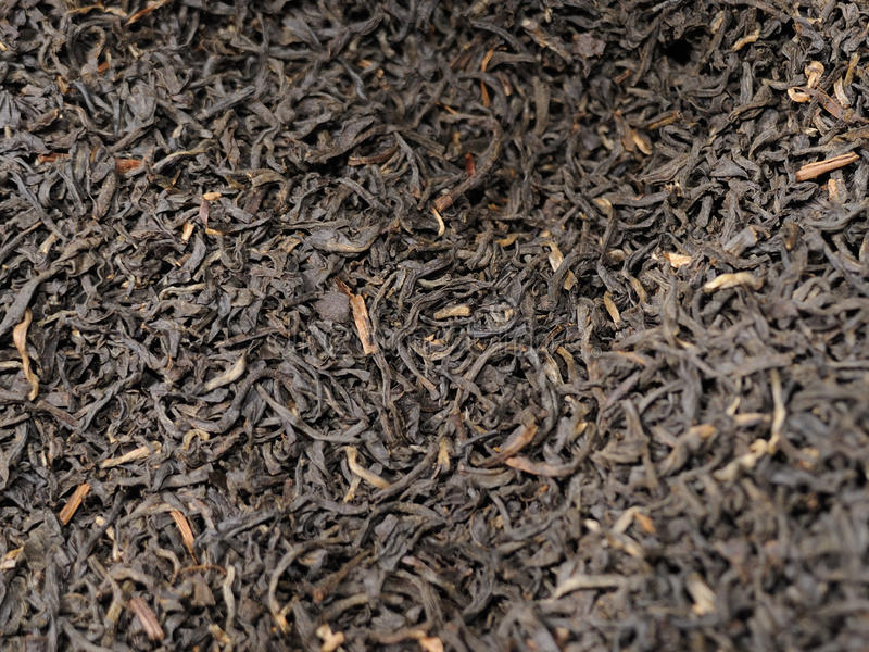 Tea leaves background. A background of dried tea leaves royalty free stock photo