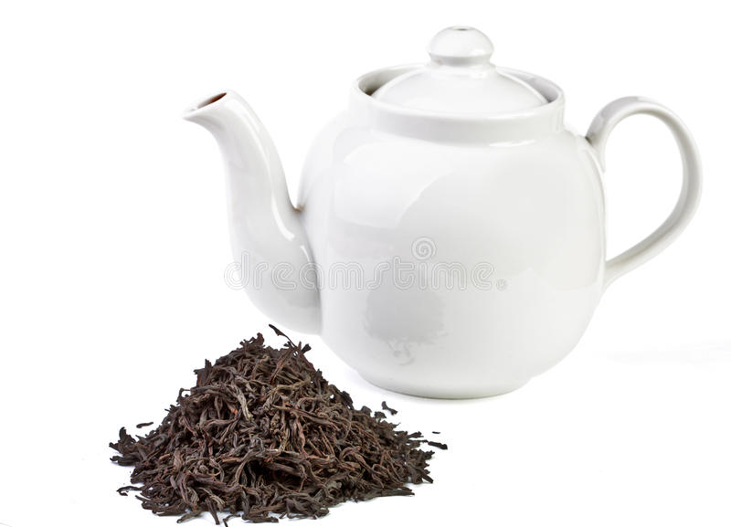Tea leaves and tea. Isolated on whie royalty free stock images