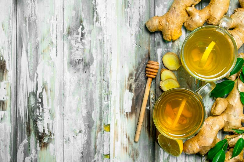 Tea with lemon and fresh ginger royalty free stock image