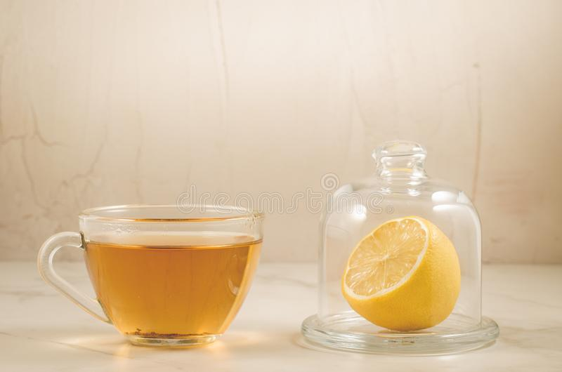 tea with a lemon and mint in glass cups stock photos