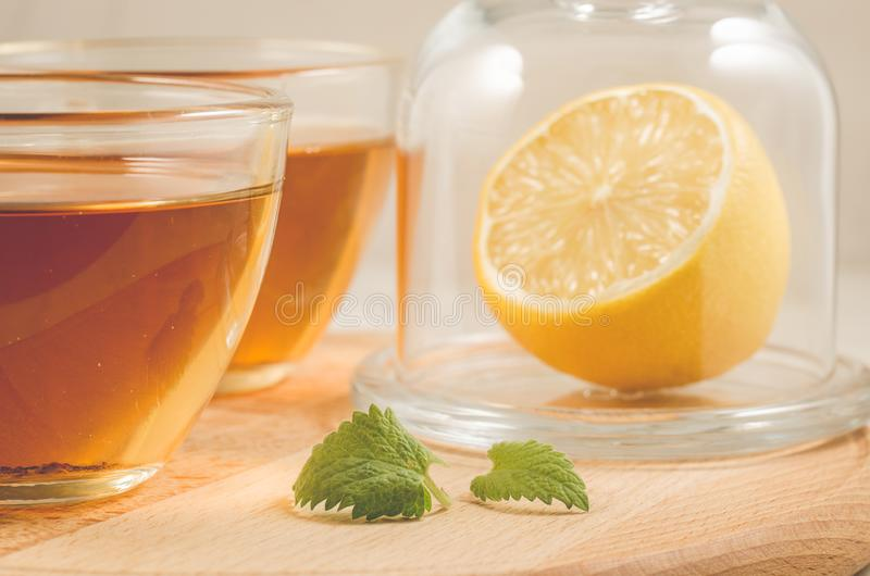 Tea with a lemon and mint in glass/tea with a lemon and mint in stock image