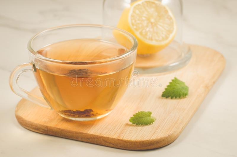 Tea with a lemon and mint in glass/tea with a lemon and mint on stock image
