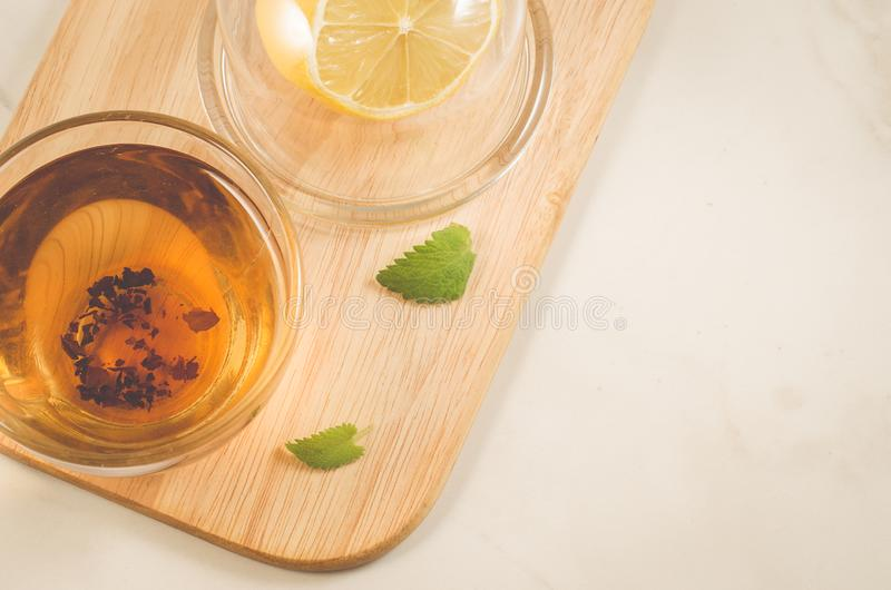 Tea with a lemon and mint in glass/tea with a lemon and mint on stock images