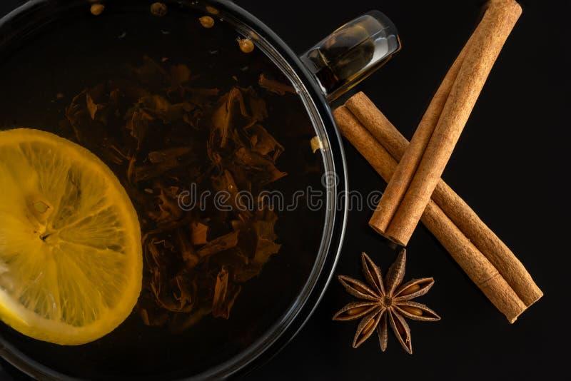 Tea with lemon. star anise and cinnamon sticks stock images