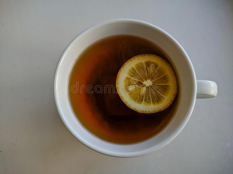 Tea with lemon on the table. View from above stock images