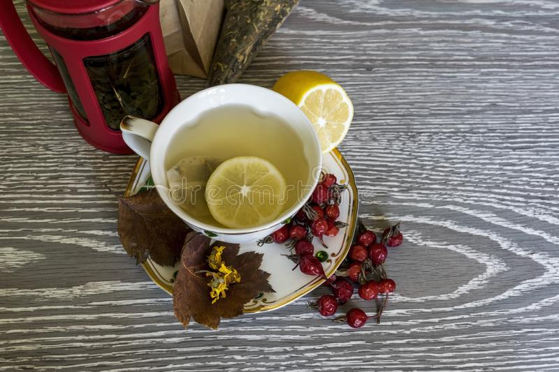 Tea with lemon. Useful products in the fall. stock photography