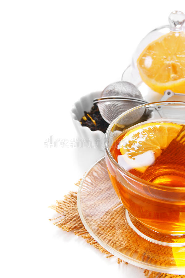 Tea with a lemon. On a white background stock photography
