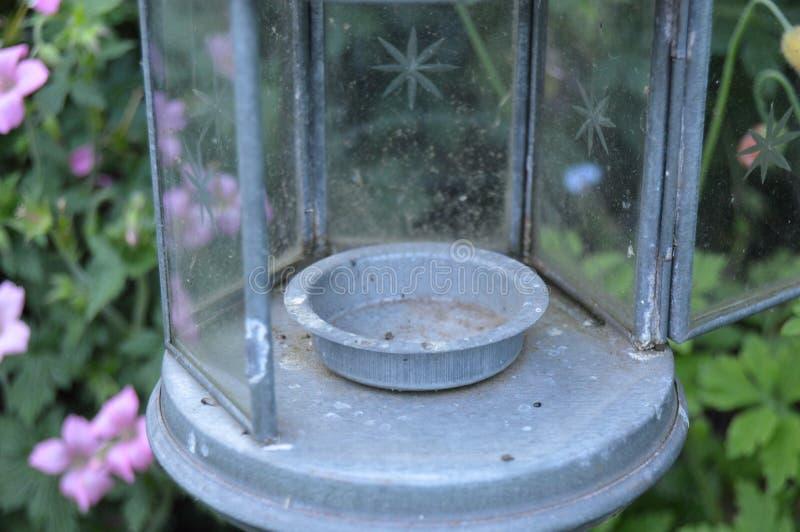Tea Light in the garden royalty free stock photo