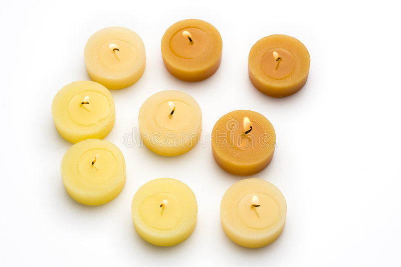 Tea lights. Yellow and orange tea lights royalty free stock photography