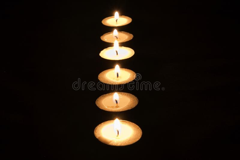 Tea Lights in a Dark Room. Can be used as background royalty free stock photo