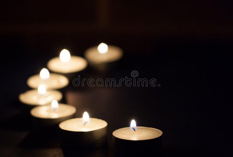 Tea lights. In a darkened room royalty free stock photo