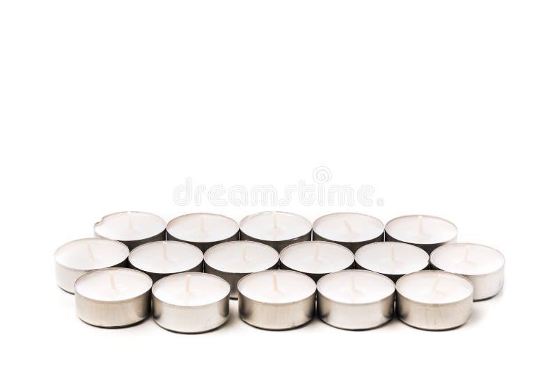 Tea lights isolated on white. Tea lights isolated on white stock photos