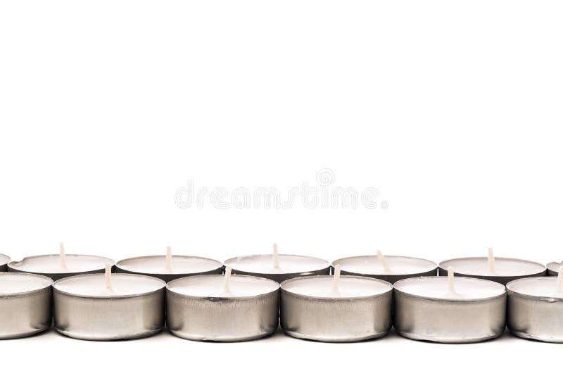 Tea lights isolated on white. Tea lights isolated on white royalty free stock photo