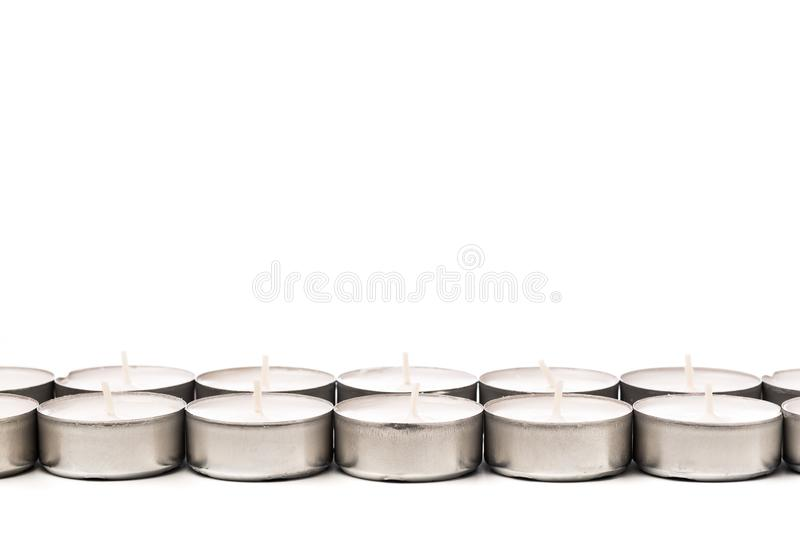 Tea lights isolated on white. Tea lights isolated on white stock images