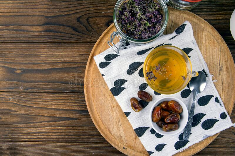 Tea with mint in arab style and dates on wooden table. Top views with clear space royalty free stock photo
