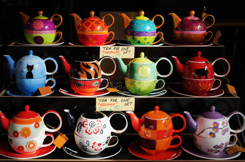 Tea for one. Colored tea sets for one person on Naschmarkt in Vienna. The teapot is standing in the teacup stock photography