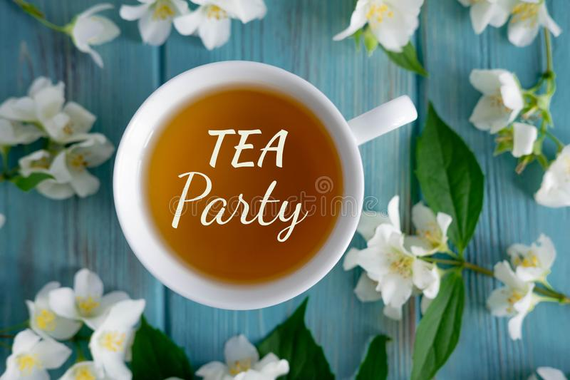 Tea party. Jasmine tea on a blue wooden background. Relaxing jasmine tea. Aromatic teas for relaxation and health stock image
