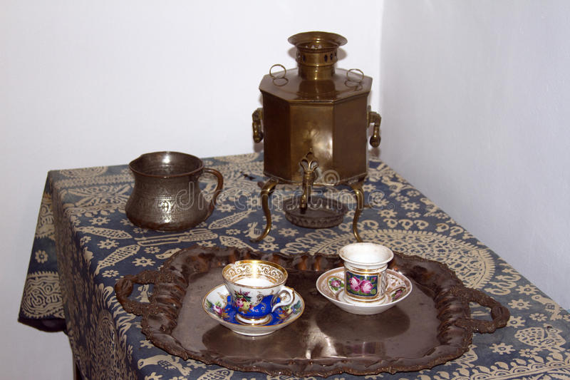 Tea party with Russian samovar tea set tableware 19th century stock images
