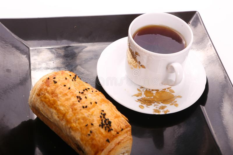 Tea with paté top view. Pate with cup of tea on modern black dish over white background royalty free stock images