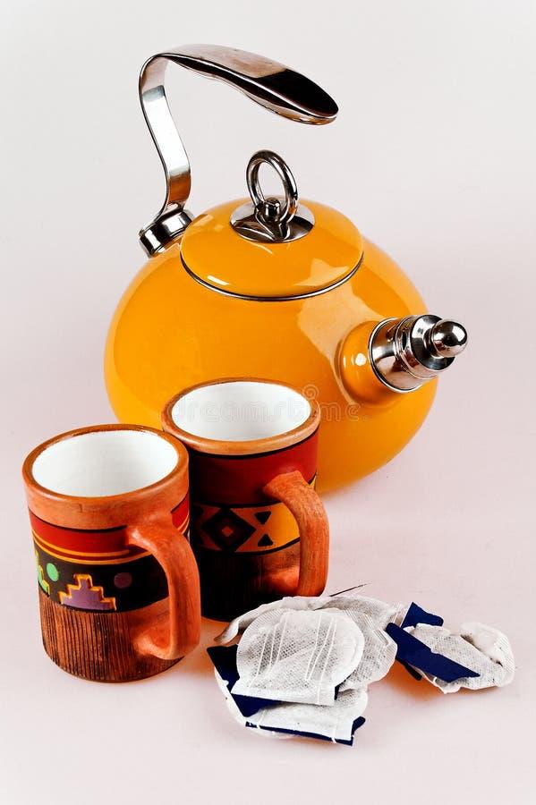 Tea pot with handmade mugs royalty free stock images