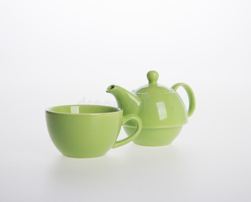 Tea pot set or Porcelain tea pot and cup on background. Tea pot set or Porcelain tea pot and cup on background royalty free stock image