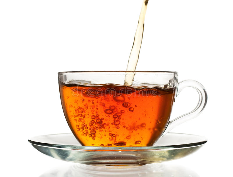 Tea pouring in the cup stock photos