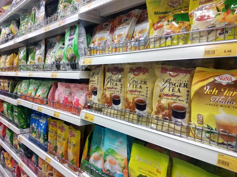 Tea powder is sold in commercial packages and displayed on supermarket shelves for sale. KUALA LUMPUR, MALAYSIA -AUGUST 16, 2019: Tea powder is sold in royalty free stock images