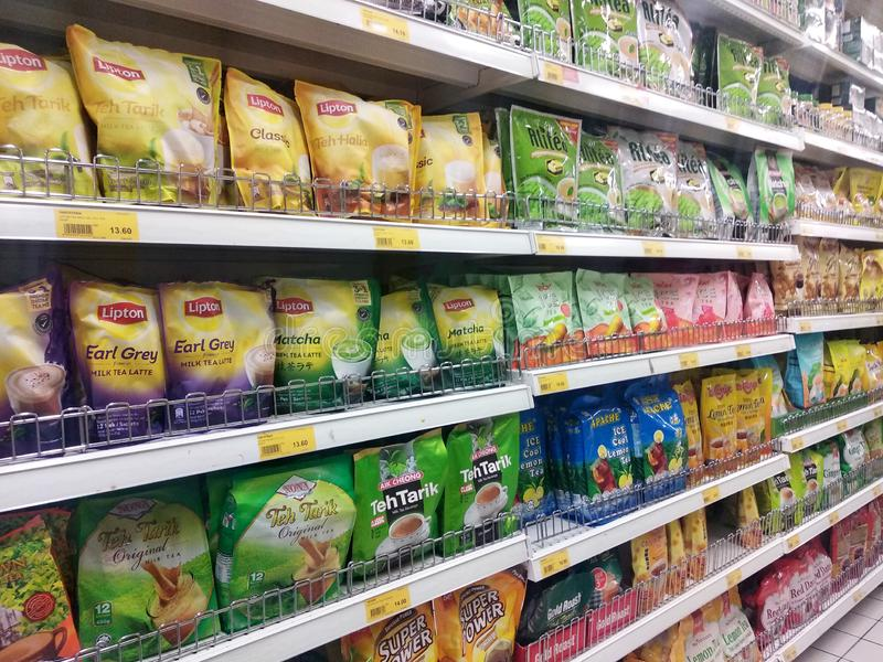 Tea powder is sold in commercial packages and displayed on supermarket shelves for sale. KUALA LUMPUR, MALAYSIA -AUGUST 16, 2019: Tea powder is sold in stock photography