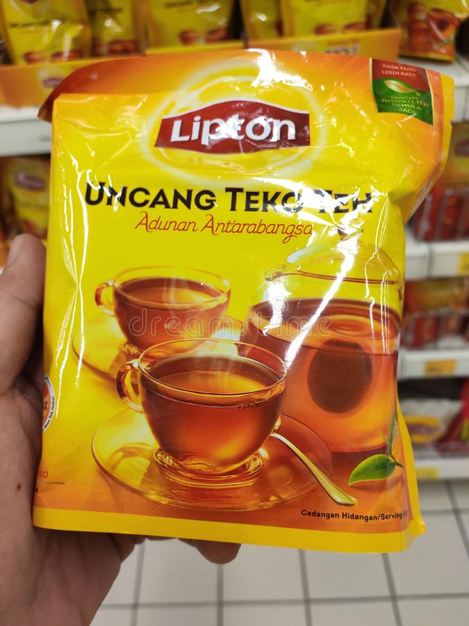 Tea powder is sold in commercial packages and displayed on supermarket shelves for sale. stock image