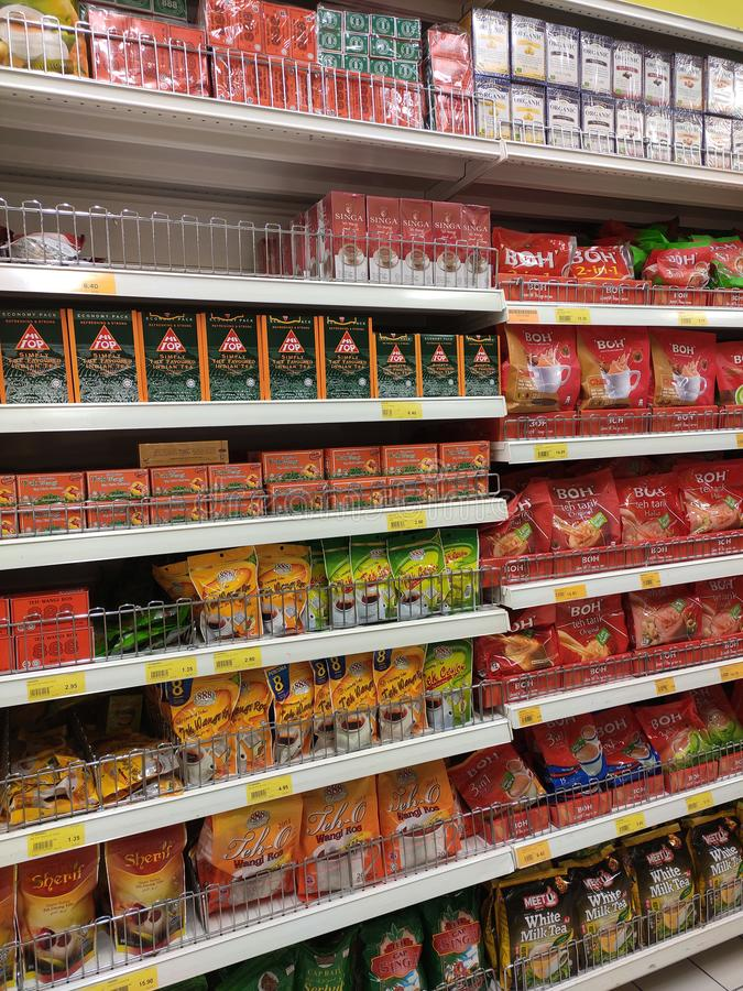 Tea powder is sold in commercial packages and displayed on supermarket shelves for sale. stock photography