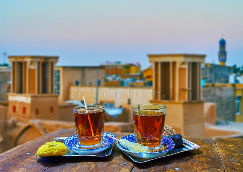 Tea on the roof, Kashan, Iran. Enjoy traditional black tea with rock sugar, fragrant almond cookies, dry fruits and nuts on the roof of old town, Kashan, Iran royalty free stock image