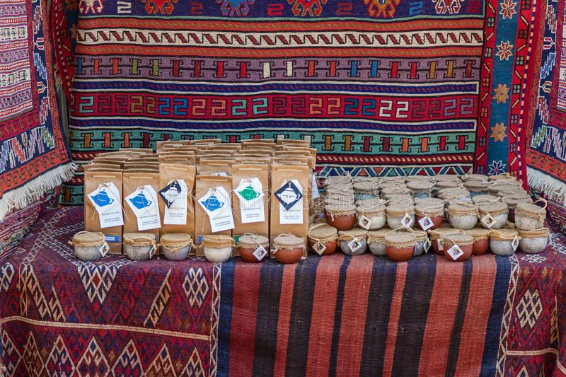 Tea for sale. Georgia Tbilisi June 17, 2017: Tea of different varieties in cans sold on a bench lying on a carpet. Tea for sale royalty free stock image