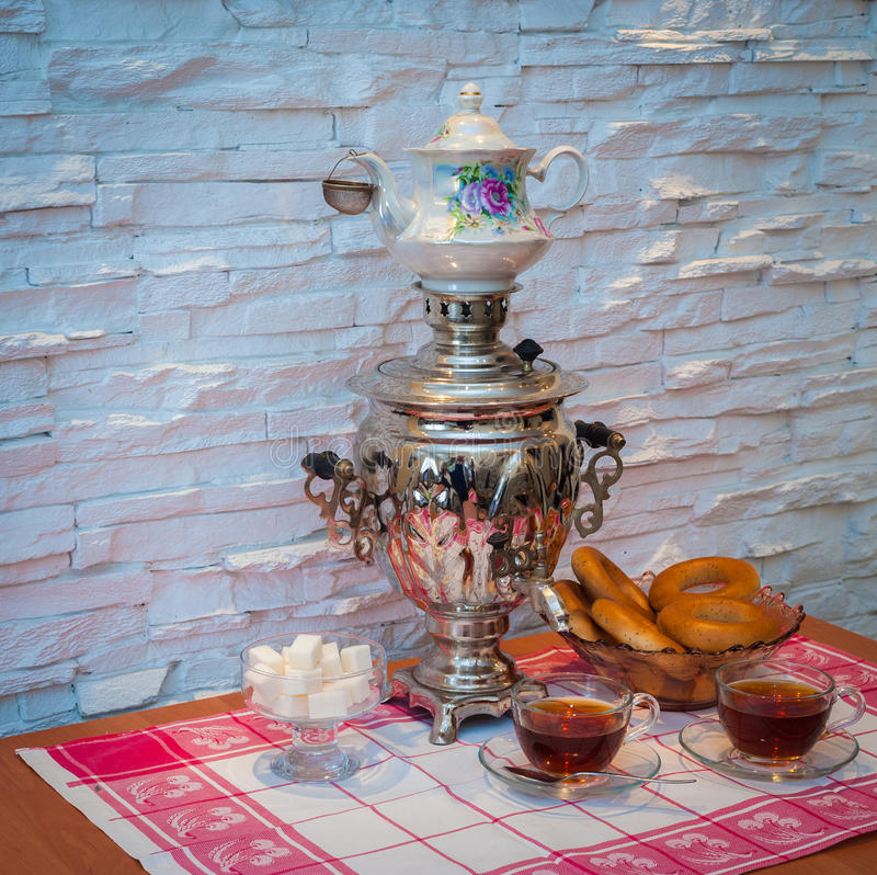 Tea samovar with bagels royalty free stock images