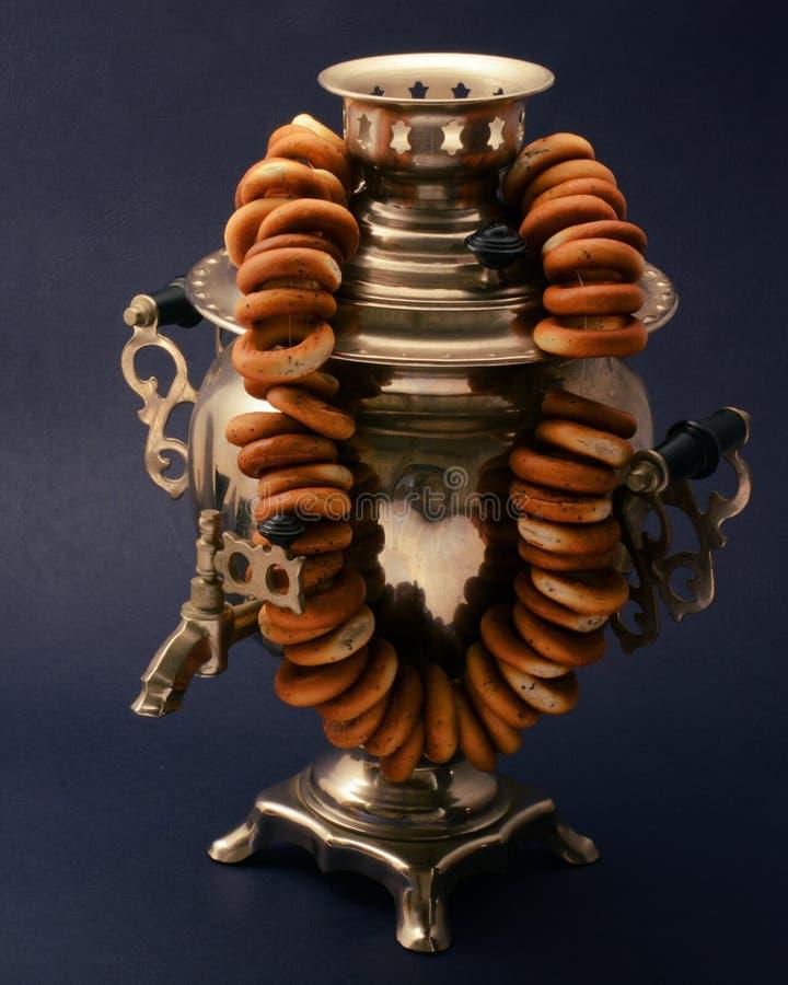 Tea samovar vintage metal on dark background with bagels royalty free stock photos