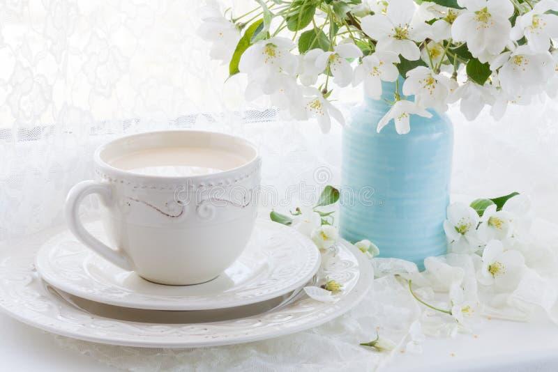 Tea service in the garden. Cups of tea and tea pot. Drinking tea stock images