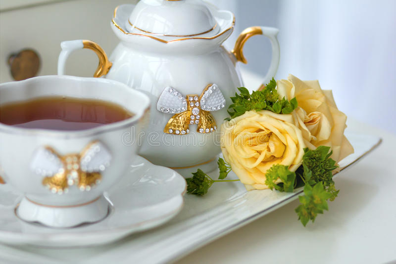 Tea service with tea and flowers stock photo